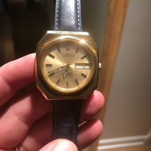 Omega gold watch